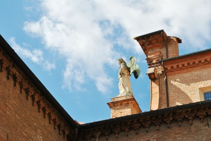 Statue of an angel on a church in Ferrara